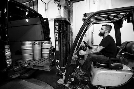 Loading kegs into a delivery van.